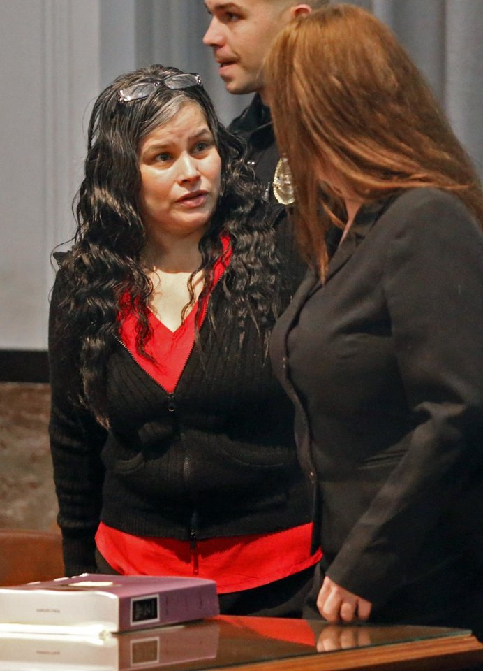 Photo -  Murder defendant Juanita Martinez Gomez appeared Tuesday in Oklahoma County District Court for trial. [Photo by Steve Sisney, The Oklahoman]