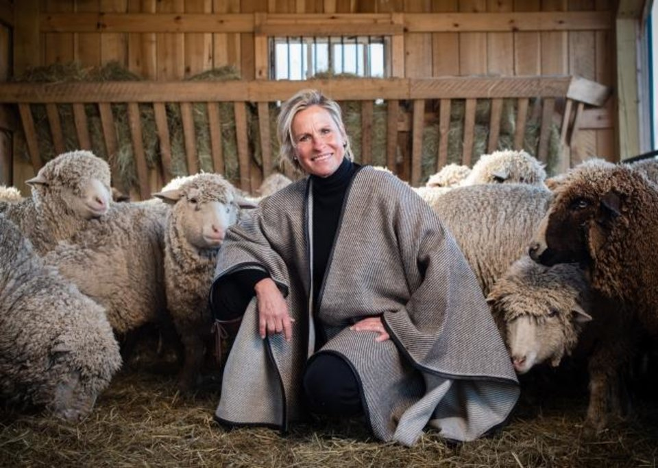 Photo -  Franny Kansteiner, owner of Gum Tree Farm Designs, raises merino wool sheep on her farm then creates sewn, knitted, woven and baby goods, all handmade, which she sells online and in her shop in Middleburg, Virginia. [The Washington Post/Andre Chung]