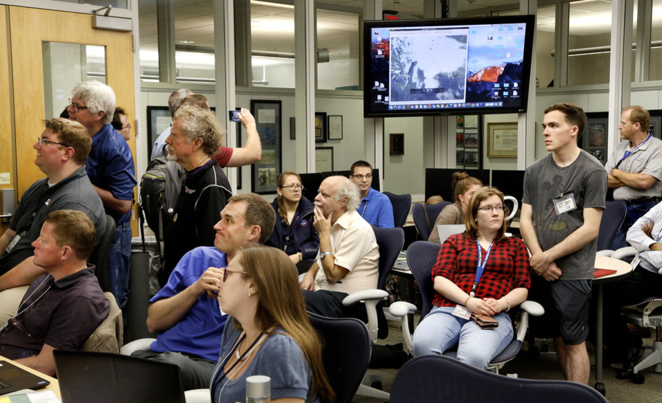 Photo - Participants from across the nation participate in a NOAA hazardous weather testbed Monday, May 20, 2019, at the NOAA (National Oceanic and Atmospheric Administration) facility  on the campus of the University of Oklahoma. They are discussing various experimental weather models.  [Jim Beckel/The Oklahoman]