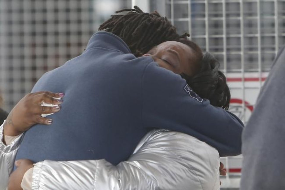 Photo -  Tondalao Hall, right, embraces family Friday after her release from Mabel Bassett Correctional Center in McLoud. [Sue Ogrocki/The Associated Press]