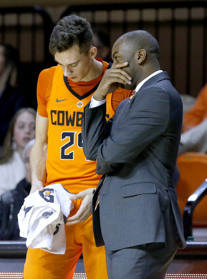 2dd1c3a54 Oklahoma State head coach Mike Boynton talks with Oklahoma State walk-on  Luke Major (24) during a gameTexas A M-Corpus Christi at Gallagher-Iba  Arena in ...