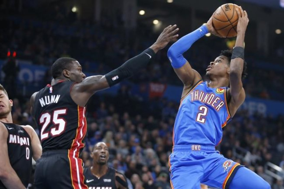 Photo -  Shai Gilgeous-Alexander (2) and the Thunder could face Kendrick Nunn (25) and the Heat in the first round of the playoffs if the NBA ditches its standard format, as reported. [Bryan Terry/The Oklahoman]