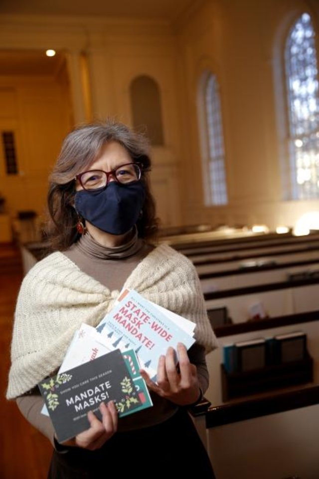 Photo -  The Rev. Diana Davies, senior minister of First Unitarian Church of Oklahoma City, holds up