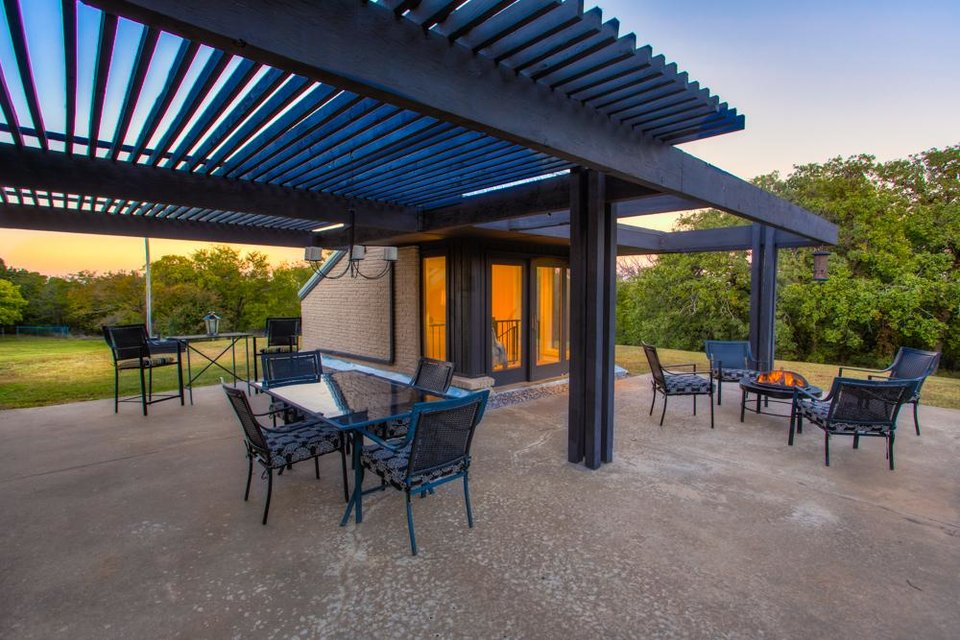Stunning Nightfall provides a soothing feel to the patio of this underground home listed with Simon Shingleton of Keller Williams Realty Elite PHOTO PROVIDED
