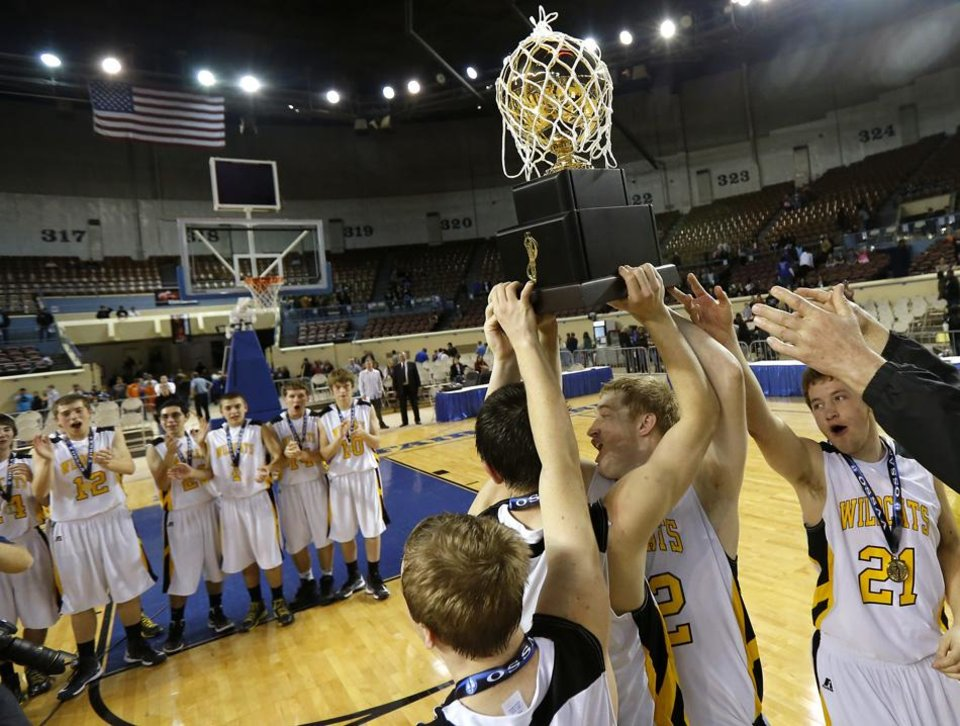 Photo -  HIGH SCHOOL BASKETBALL / STATE TOURNAMENT / CELEBRATION: Arnett celebrates with the trophy after winning the Class B boys state championship game between Coyle and Arnett in the State Fair Arena at State Fair Park in Oklahoma City, Saturday, March 2, 2013. Photo by Bryan Terry, The Oklahoman