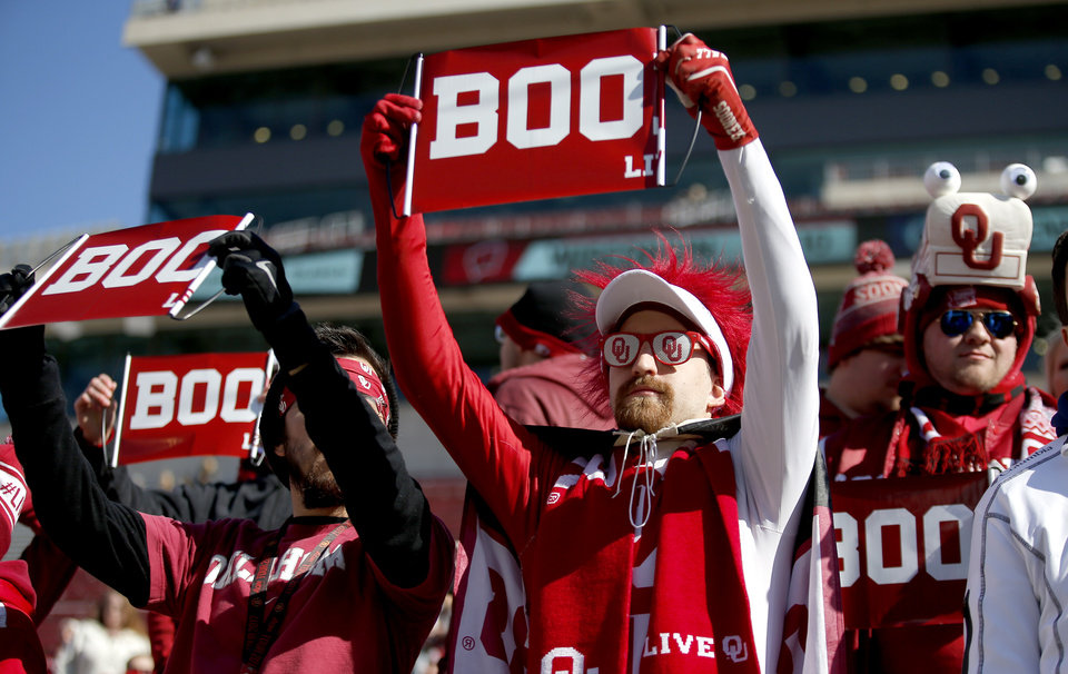 Photo - Fans hold up signs as OSU special teams players warm up during a Bedlam college football game between the University of Oklahoma Sooners (OU) and the Oklahoma State University Cowboys (OSU) at Gaylord Family-Oklahoma Memorial Stadium in Norman, Okla., Nov. 10, 2018.  Photo by Sarah Phipps, The Oklahoman