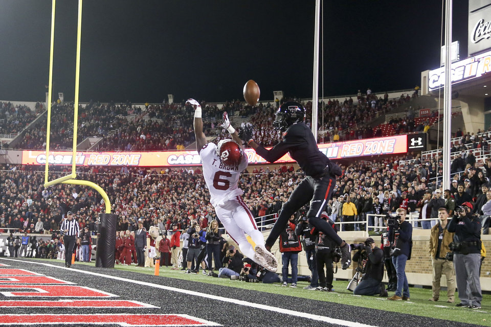 Photo - Oklahoma Sooners cornerback Tre Brown (6) knocks away a pass intended for Texas Tech Red Raiders wide receiver Antoine Wesley (4) during the NCAA football game between the Texas Tech Red Raiders and the Oklahoma Sooners at Jones AT&T Stadium in Lubbock, Texas on Saturday, November 03, 2018. IAN MAULE/Tulsa World