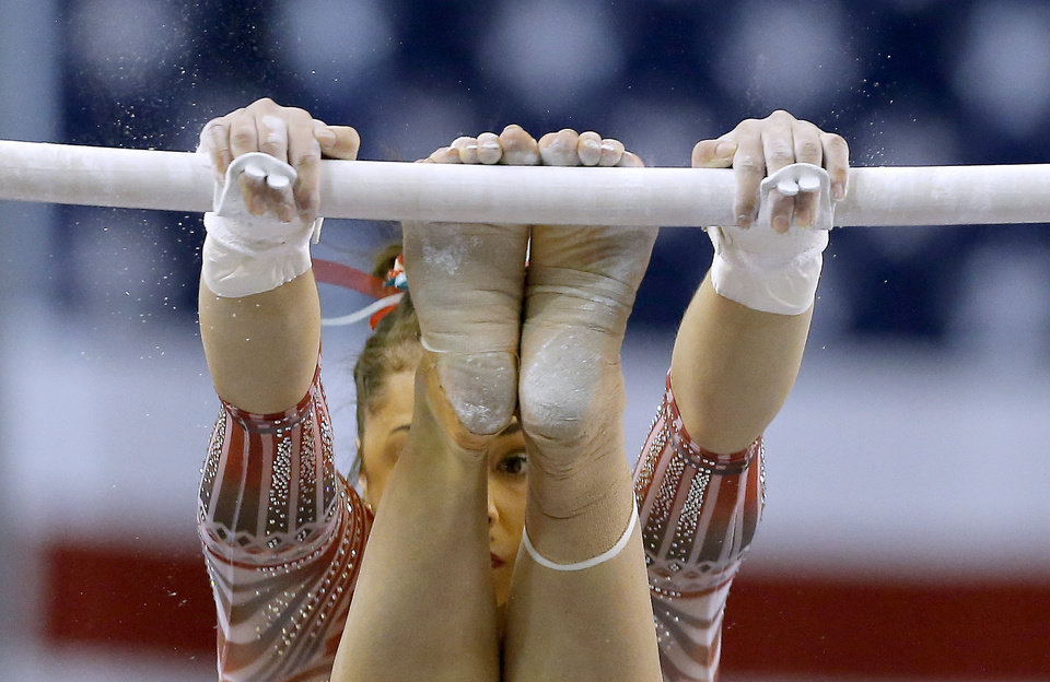 Photo - OU's Maggie Nichols performs in the uneven bars Perfect 10 Challenge women's gymnastics meet between Oklahoma and Nebraska, part of the Bart and Nadia Sports Experience, at the Cox Convention Center in Oklahoma City, Friday, Feb. 16, 2018. Photo by Sarah Phipps, The Oklahoman