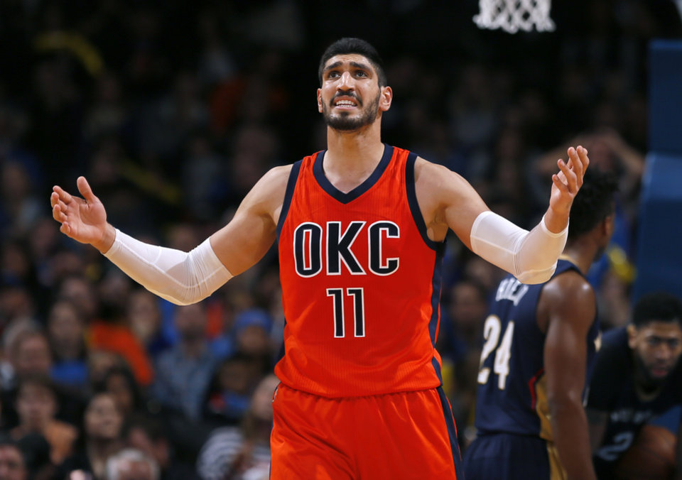 Photo - Oklahoma City's Enes Kanter (11) reacts during the NBA game between the Oklahoma City Thunder and the New Orleans Pelicans at the Chesapeake Energy Arena,  Sunday, Dec. 4, 2016. Photo by Sarah Phipps, The Oklahoman