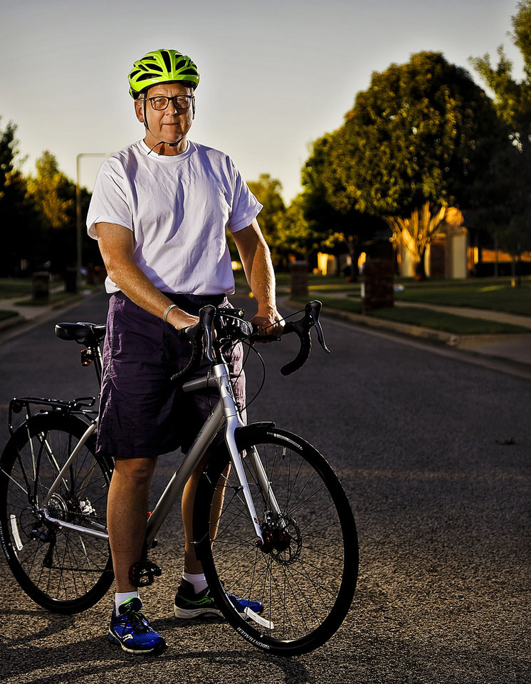 Photo -  Ward 5 Councilman David Greenwell began commuting this fall by bicycle from his home in southwest Oklahoma City to his office downtown. The city is stepping up efforts to improve safety for bicyclists and pedestrians. [Chris Landsberger]