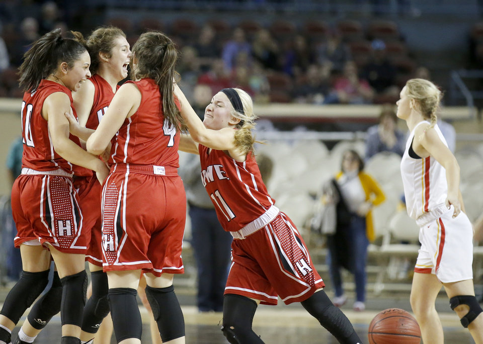 Photo - Howe celebrates the 2A girls state high school basketball championship as Dale's Jacie McClure walks off the court at Jim Norick State Fair Arena, the Big House, at State Fair Park in Oklahoma City,  Saturday, March 9, 2019. Photo by Sarah Phipps, The Oklahoman