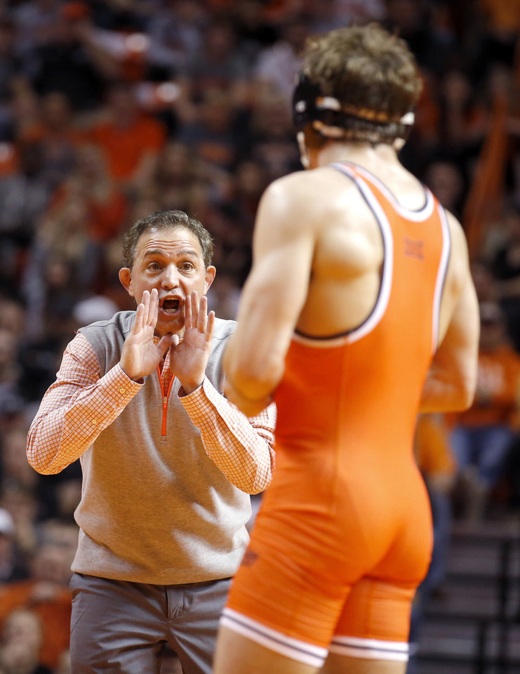 Photo - Oklahoma State head coach John Smith talks with Oklahoma State's Anthony Collica as he wrestles Penn State's Zain Retherford in the 149-pound match during the wrestling dual between Oklahoma State and Penn State at Gallagher-Iba Arena in Stillwater, Okla.,  Saturday, Feb. 18, 2017.  Photo by Sarah Phipps, The Oklahoman