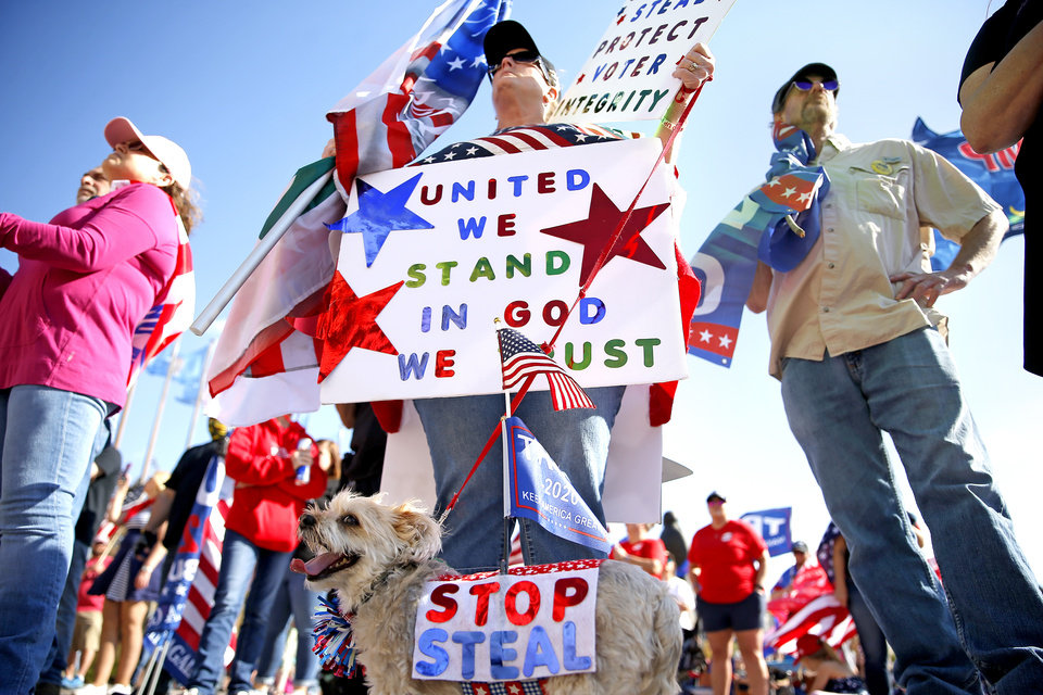 Photo - Ronda Peterson and Paisley of Edmond, Okla.,  listed to speakers during a rally for President Trump at the Oklahoma state Capitol in Oklahoma City,  Saturday, Nov. 7, 2020. [Sarah Phipps/The Oklahoman]