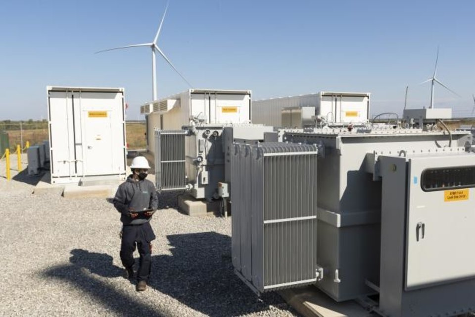 Photo -  NextEra Energy Resources' Justin Cuadra checks battery storage transformers as part of his daily inspections at the Rush Springs Energy Storage facility. [PHOTO PROVIDED/NEXTERA ENERGY RESOURCES]