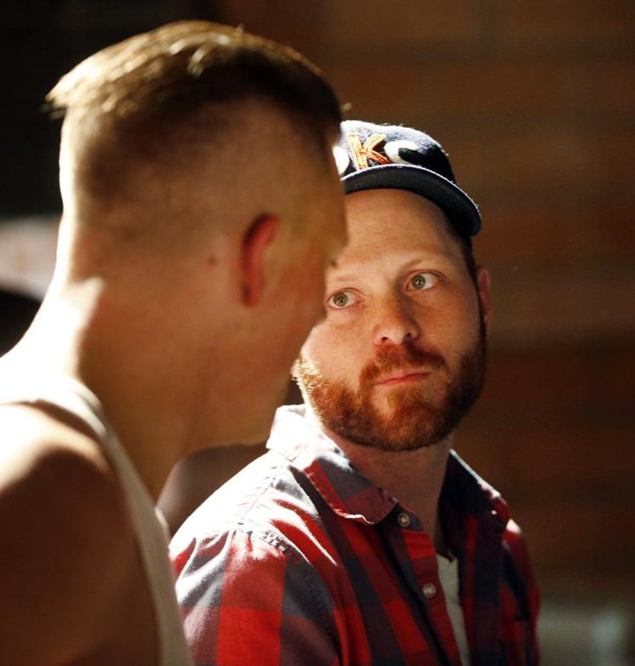 Photo - irector Kyle Roberts, right, talks with actor Stephen Goodman during filming of Roberts' short film