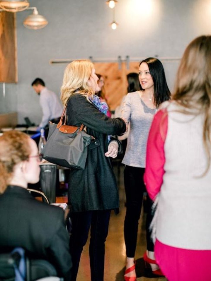 Photo -  Women greet each other at the inaugural Polished OKC lunch at Packard's, 201 NW 10. [Water and Grace Photography]
