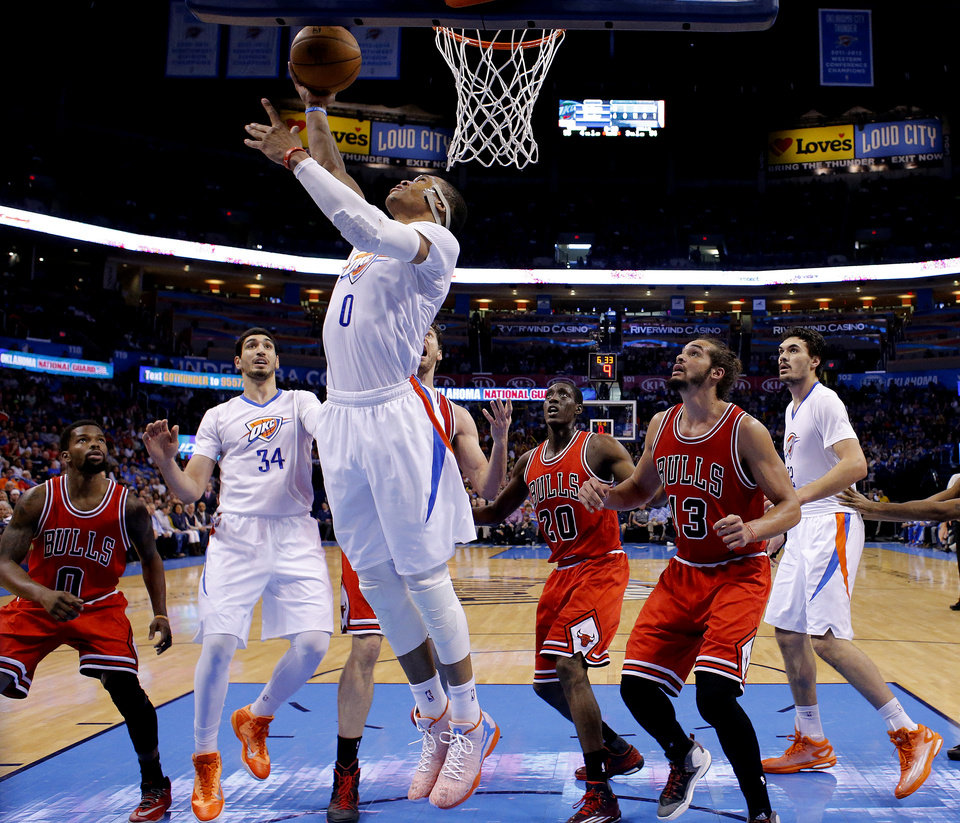 Photo - Oklahoma City's Russell Westbrook (0) shoots a lay up during the NBA game between the Oklahoma City Thunder and the Chicago Bulls at Chesapeake Energy Arena in Oklahoma City, Sunday, March  15, 2015. Photo by Sarah Phipps, The Oklahoman