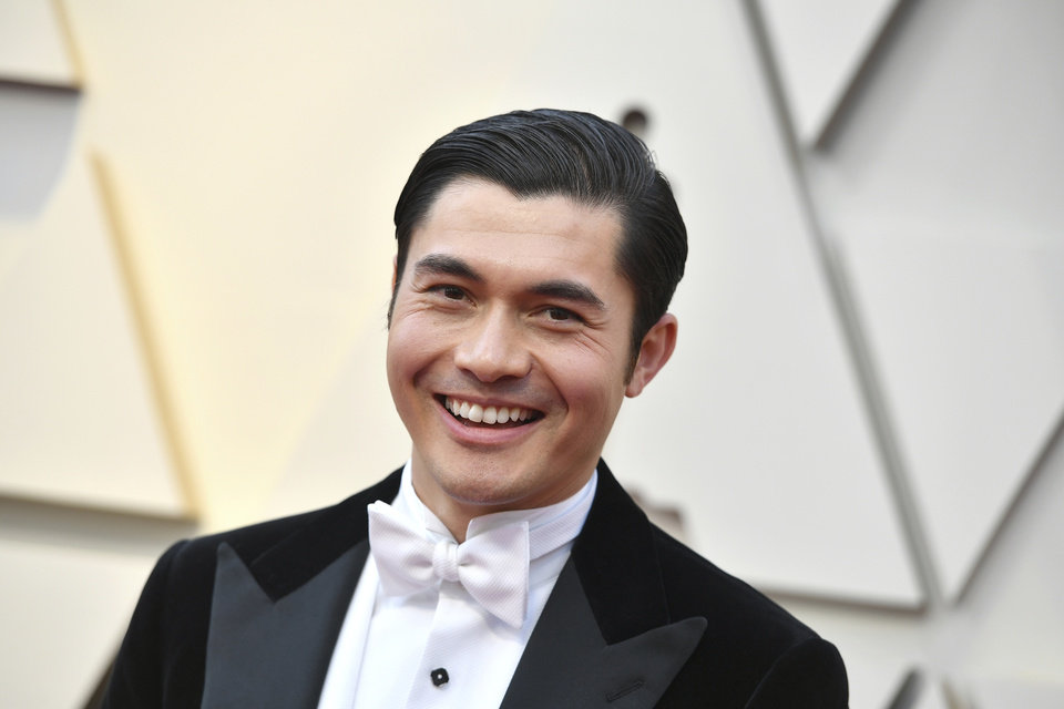 Photo -  Henry Golding arrives at the Oscars on Sunday, Feb. 24, 2019, at the Dolby Theatre in Los Angeles. (Photo by Jordan Strauss/Invision/AP)