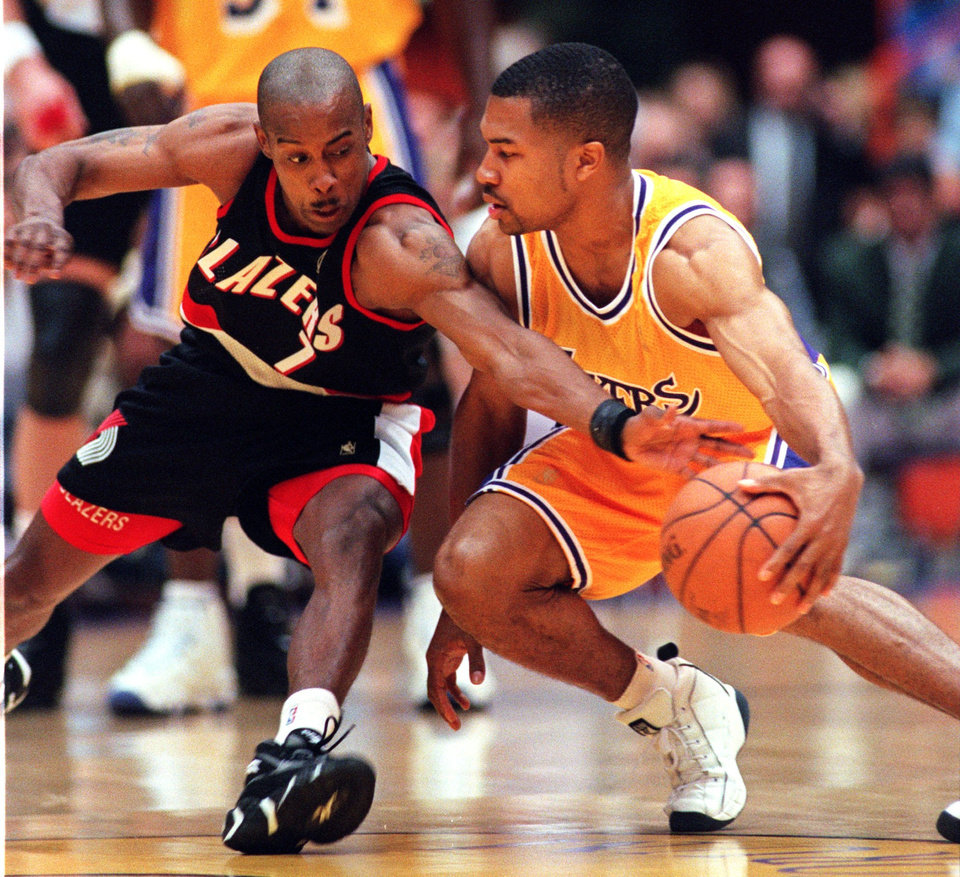 Photo - Kenny Anderson of the Portland Trail Blazers, left, steals the basketball from Derek Fisher of the Los Angeles Lakers during the first half of their playoff game Sunday, April 27, 1997, in Inglewood, Calif.  (AP Photo/Mark J. Terrill)