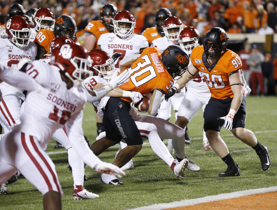 Photo - Oklahoma State's Chuba Hubbard (30) rushes for a touchdown in the first quarter during the Bedlam college football game between the Oklahoma State Cowboys (OSU) and Oklahoma Sooners (OU) at Boone Pickens Stadium in Stillwater, Okla., Saturday, Nov. 30, 2019. [Nate Billings/The Oklahoman]