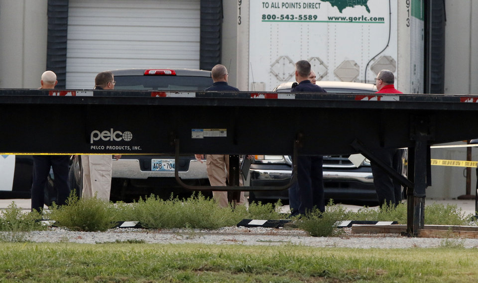 Photo - Police investigate an early morning shooting that left one person injured at Pelco Products at 320 W 18th St. in Edmond, Okla. Tuesday, Aug. 8, 2017.  Photo by Paul Hellstern, The Oklahoman