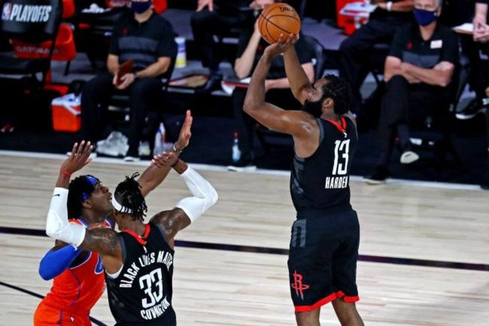 Photo -  Aug 29, 2020; Lake Buena Vista, Florida, USA; Houston Rockets guard James Harden (13) shoots the ball against Oklahoma City Thunder guard Luguentz Dort (5) during the first quarter in game five of the first round of the 2020 NBA Playoffs at The Field House. Mandatory Credit: Kim Klement-USA TODAY Sports