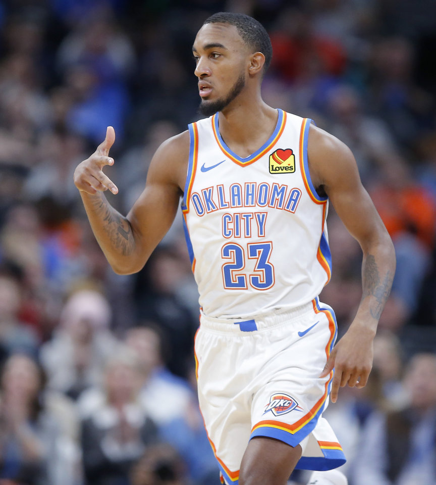 Photo - Oklahoma City's Terrance Ferguson (23) celebrates a basket during an NBA basketball game between the Oklahoma City Thunder and the Memphis Grizzlies at Chesapeake Energy Arena in Oklahoma City, Wednesday, Dec. 18, 2019. Oklahoma City won 126-122. [Bryan Terry/The Oklahoman]