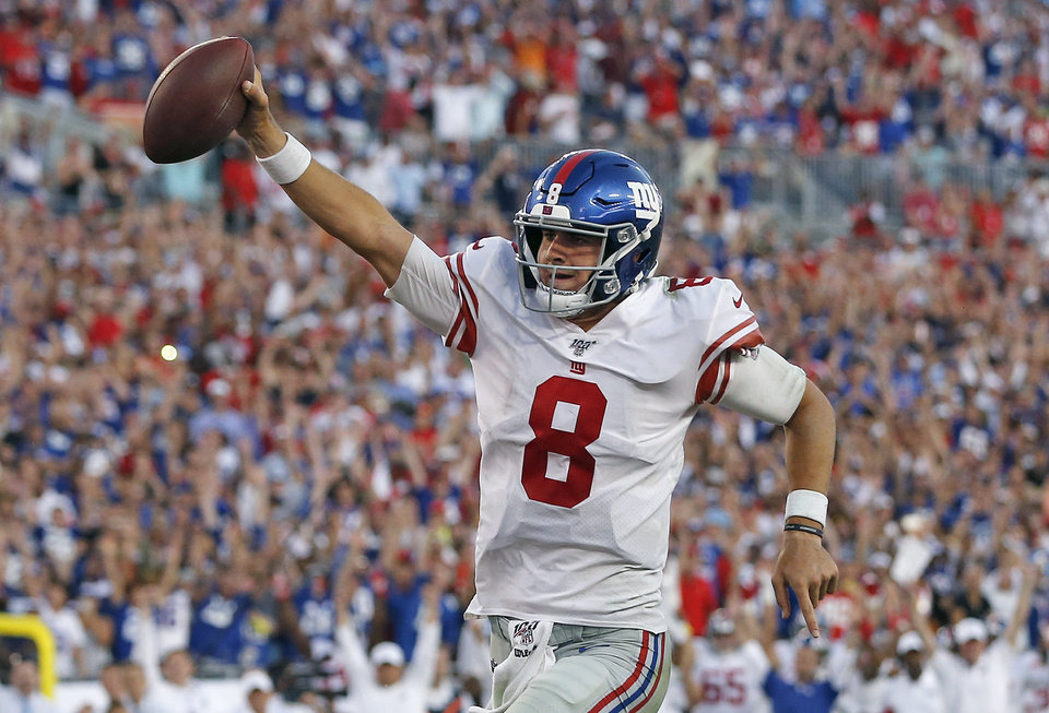 Photo - New York Giants quarterback Daniel Jones (8) runs 7-yards for a touchdown during the second half of an NFL football game against the Tampa Bay Buccaneers Sunday, Sept. 22, 2019, in Tampa, Fla. (AP Photo/Mark LoMoglio)