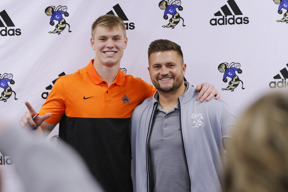 Photo - Head coach Jake Corbin and Jeff Roberson, Choctaw, who signed with OSU during National Signing Day for high school football players, Wednesday, December 18, 2019. [Photo by Doug Hoke/The Oklahoman]