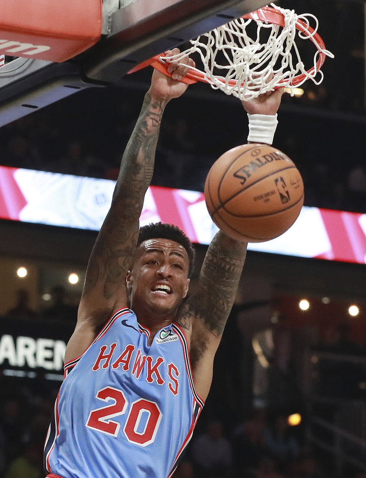 Photo - Atlanta Hawks forward John Collins (20) dunks against the Oklahoma City Thunder during the first half of an NBA basketball game on Tuesday, Jan. 15, 2019, at State Farm Arena in Atlanta. (Curtis Compton/Atlanta Journal-Constitution via AP)