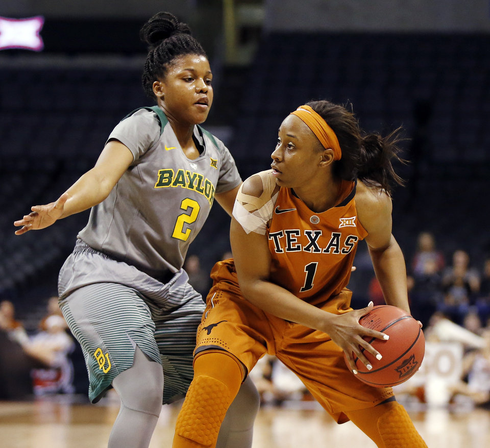 Photo - Baylor's Niya Johnson (2) defends Texas' Empress Davenport (1) during the Big 12 Women's Basketball Championship final between the Texas Longhorns and the Baylor Lady Bears at Chesapeake Energy Arena in Oklahoma City, Monday, March 7, 2016. Photo by Nate Billings, The Oklahoman