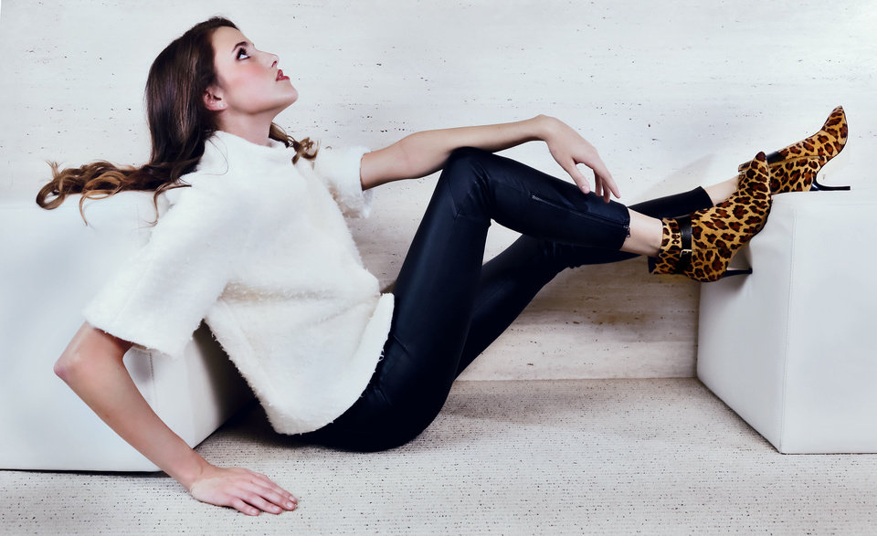 Photo - Diane von Furstenberg calf fur booties, Paige ankle-zip leather pants and Milly ivory jacket from Balliets. Model is Claire. Makeup by Tracy Walls, Balliets. Photo by Chris Landsberger, The Oklahoman  CHRIS LANDSBERGER