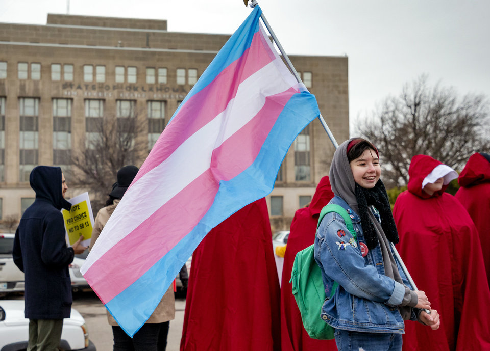 Photo - Pro-Choice supporter Spencer Turner carries a transgender flag during a Pro-Choice rally against Senate Bill 13 that would abolish abortion in the state of Oklahoma at the State Capitol in Oklahoma City, Okla. on Tuesday, Feb. 11, 2020.  [Chris Landsberger/The Oklahoman]