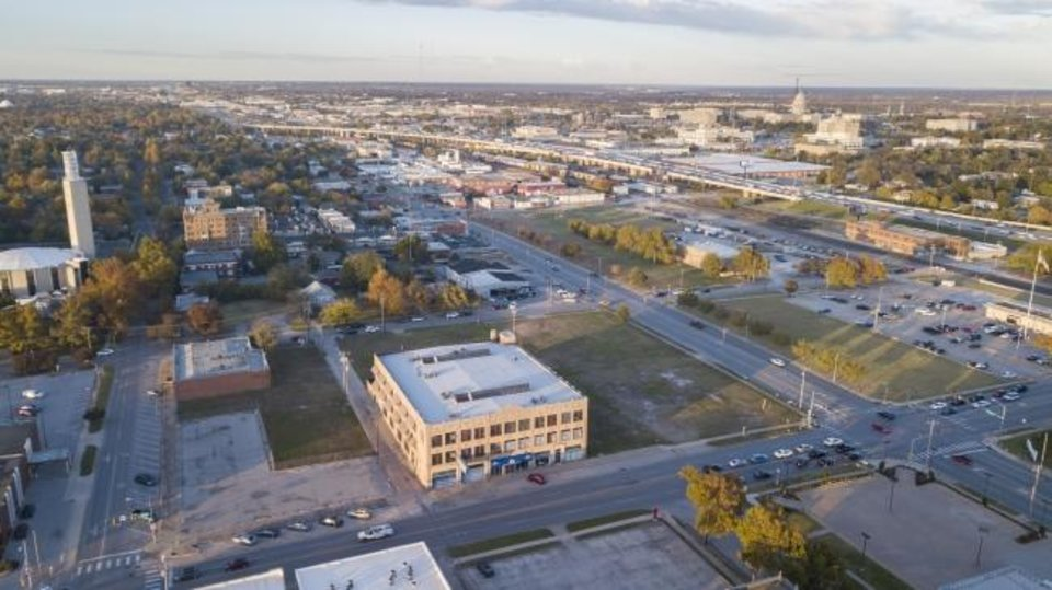 Photo -  Vacant land around the Garage Loft Apartments at NW 13 and Broadway, shown in the center of this photo, is set to be developed into a mix of apartments, offices and retail. [DAVID MORRIS/THE OKLAHOMAN]