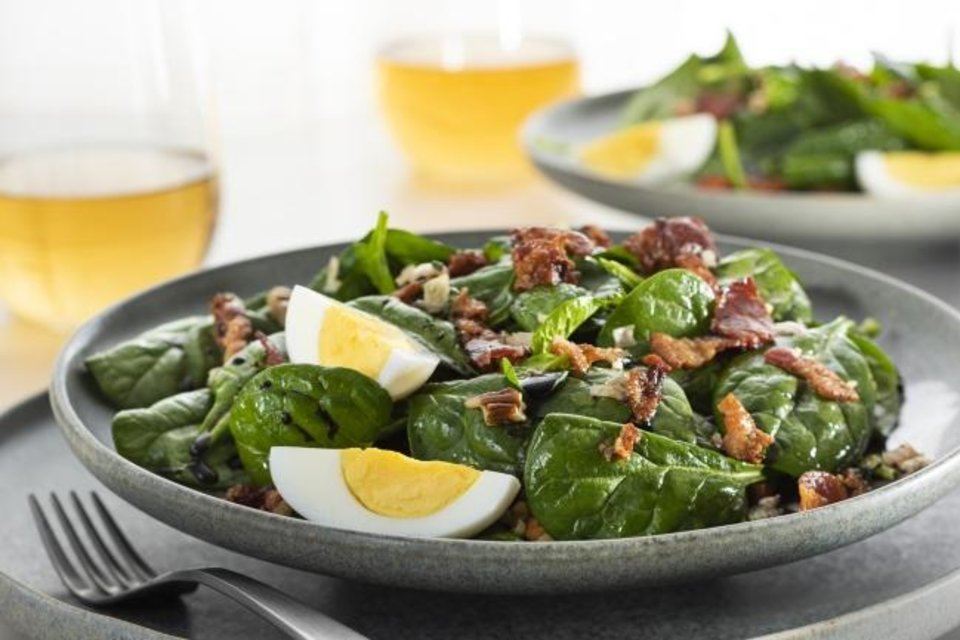 Photo -  Local spinach and warm bacon make a great foundation for salad like this one from the Made in Oklahoma Coalition. [Photo provided]