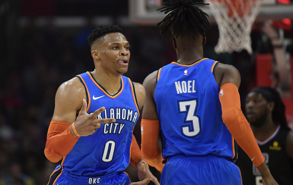 Photo - Oklahoma City Thunder guard Russell Westbrook, left, gestures after scoring as he passes forward Nerlens Noel during the first half of an NBA basketball game against the Los Angeles Clippers on Friday, March 8, 2019, in Los Angeles. (AP Photo/Mark J. Terrill)
