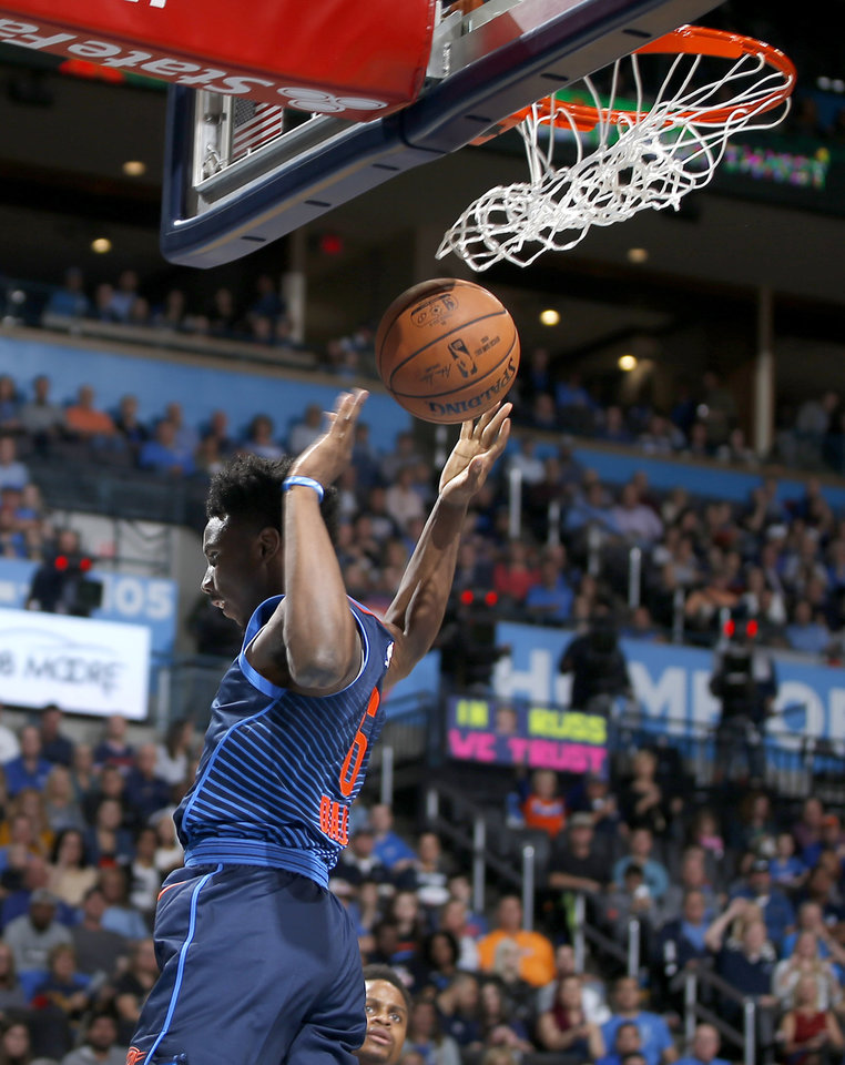 Photo - Oklahoma City's Hamidou Diallo (6) dunks during an NBA basketball game between the Oklahoma City Thunder and the Sacramento Kings at Chesapeake Energy Arena in Oklahoma City, Sunday, Oct. 21, 2018. Photo by Bryan Terry, The Oklahoman