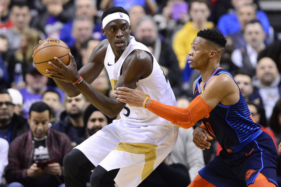Photo - Toronto Raptors forward Pascal Siakam (43) controls the ball as Oklahoma City Thunder guard Russell Westbrook (0) defends during second-half NBA basketball game action in Toronto, Friday, March 22, 2019. (Frank Gunn/The Canadian Press via AP)