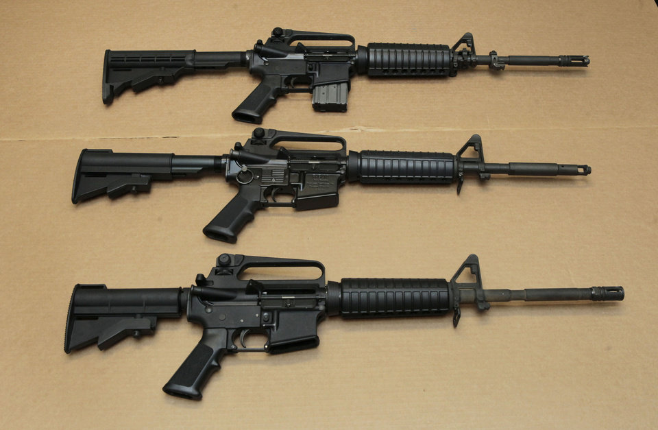 Photo - FILE -- In this Aug. 15, 2012 file photo, three variations of the AR-15 assault rifle are displayed at the California Department of Justice in Sacramento, Calif. While the guns look similar, the bottom version is illegal in California because of its quick reload capabilities. Omar Mateen used an AR-15 that he purchased legally when he killed 49 people in an Orlando nightclub over the weekend President Barack Obama and other gun control advocates have repeatedly called for reinstating a federal ban on semi-automatic assault weapons that expired in 2004, but have been thwarted by Republicans in Congress. (AP Photo/Rich Pedroncelli,file)