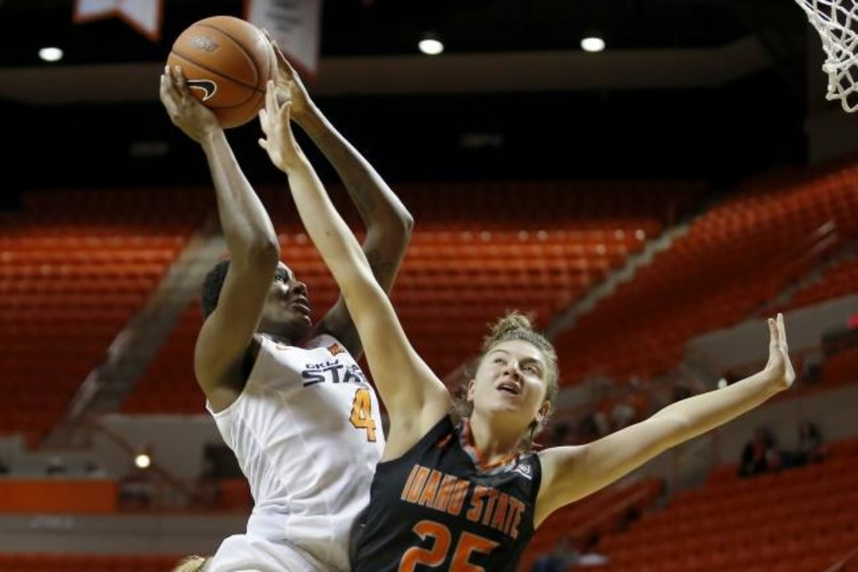 Photo -  Oklahoma State's Natasha Mack, left, goes to the basket beside Idaho State's Montana Oltrogge during a November 2019 game in Gallagher-Iba Arena. [Bryan Terry/The Oklahoman]