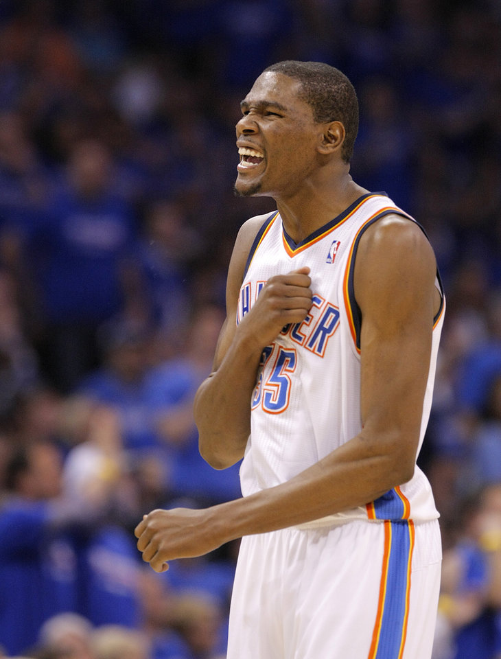 Photo - Oklahoma City's Kevin Durant (35) reacts in the final minutes of the 107-103 win over Denver during the first round NBA basketball playoff game between the Oklahoma City Thunder and the Denver Nuggets on Sunday, April 17, 2011, in Oklahoma City, Okla. Photo by Chris Landsberger, The Oklahoman
