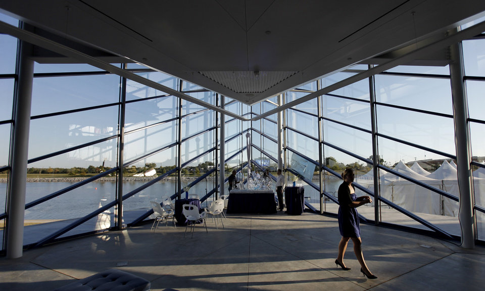 A Guest Walks Through The Boathouse During Dedication Of Devon On Oklahoma River Thursday Oct 7 2010 Photo By Doug Hoke