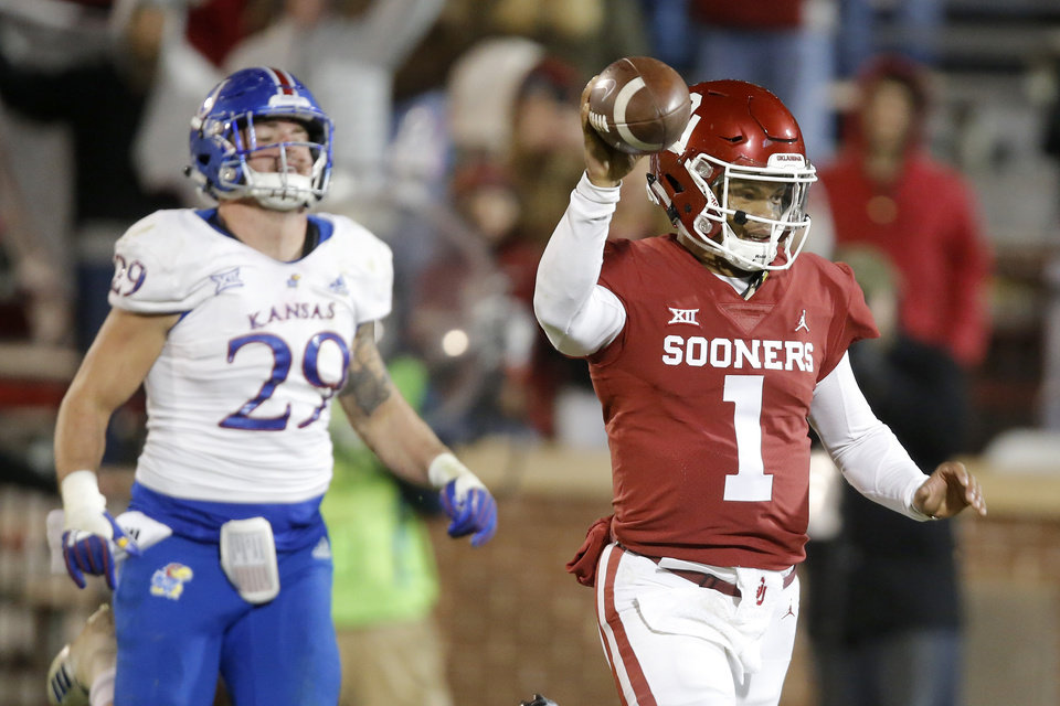 Photo - Oklahoma's Kyler Murray (1) celebrates as goes 75 yards for a touchdown during a college football game between the University of Oklahoma Sooners (OU) and the Kansas Jayhawks (KU) at Gaylord Family-Oklahoma Memorial Stadium in Norman, Okla., Saturday, Nov. 17, 2018. Photo by Bryan Terry, The Oklahoman