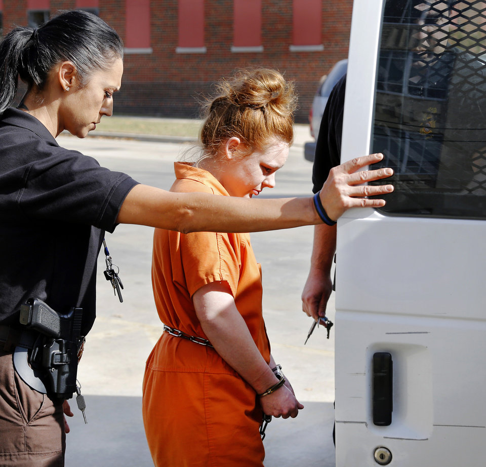 Photo - Brooklyn Danielle Williams is put inside a prisoner transport van outside the Pottawatomie County Courthouse Thursday, Nov. 10, 2017.  Nov. 8, 2017. Photo by Jim Beckel, The Oklahoman