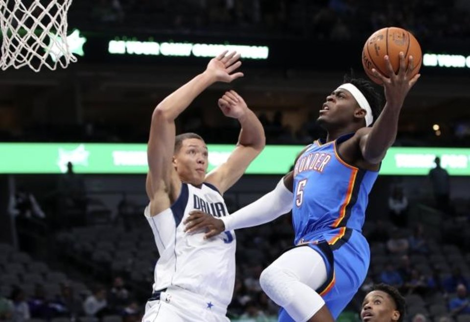 Photo -  Oklahoma City Thunder guard Luguentz Dort, right, shoots as Dallas Mavericks forward Isaiah Roby defends at American Airlines Center. [Kevin Jairaj-USA TODAY Sports]