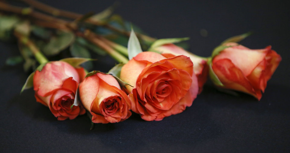Photo -  Roses on a table in the fourth floor rotunda during the Rose Day, an annual anti-abortion event, at the state Capitol in Oklahoma City, Wednesday, Feb. 6, 2019. [Nate Billings/The Oklahoman]