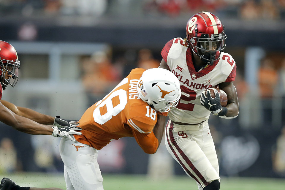 Photo - Oklahoma's CeeDee Lamb (2) runs past Davante Davis (18) of Texas during the Big 12 Championship football game between the Oklahoma Sooners (OU) and the Texas Longhorns (UT) at AT&T Stadium in Arlington, Texas, Saturday, Dec. 1, 2018.  Oklahoma won 39-27. Photo by Bryan Terry, The Oklahoman
