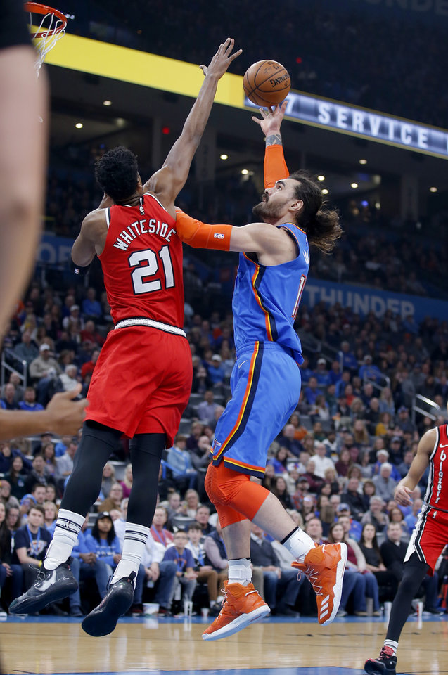 Photo - Oklahoma City's Steven Adams (12) shoots over Portland's Hassan Whiteside (21) during the NBA basketball game between the Oklahoma City Thunder and the Portland Trail Blazers at the Chesapeake Energy Arena in Oklahoma City, Saturday, Jan. 18, 2020.  [Sarah Phipps/The Oklahoman]