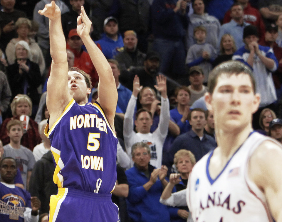 Photo - UNI's Ali Farokhmanesh (5) shoots a three-point shot to put the Panthers up 66-62 behind Tyrel Reed (14) of KU late in the second half during the NCAA Men's basketball tournament second round game between the University of Kansas and the University of Northern Iowa at the Ford Center in Oklahoma City, Saturday, March 20, 2010. UNI upset KU, 69-67. Photo by Nate Billings, The Oklahoman ORG XMIT: KOD