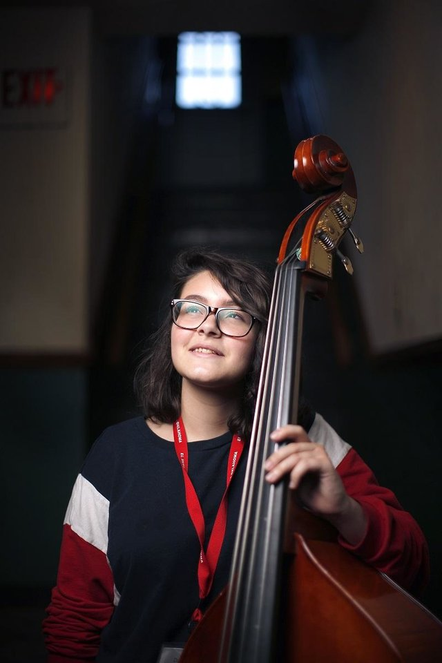 "Photo - Dacey Tietz of the El Sistema Oklahoma program poses for a photo at First Presbyterian Church of Oklahoma City, Thursday, Sept. 19, 2019. Tietz composed ""Adventurous Voyage,"